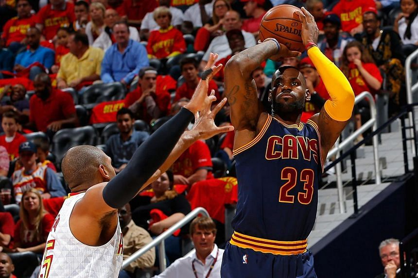 LeBron James #23 of the Cleveland Cavaliers shooting against Al Horford #15 of the Atlanta Hawks in Game Three of the Eastern Conference Semifinals on May 6, 2016.