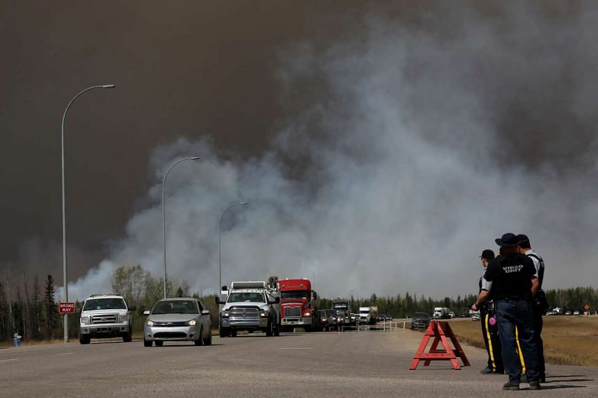 Evacuees who were stranded north of Fort McMurray head south of Fort McMurray on Highway 63, on May 6, 2016.