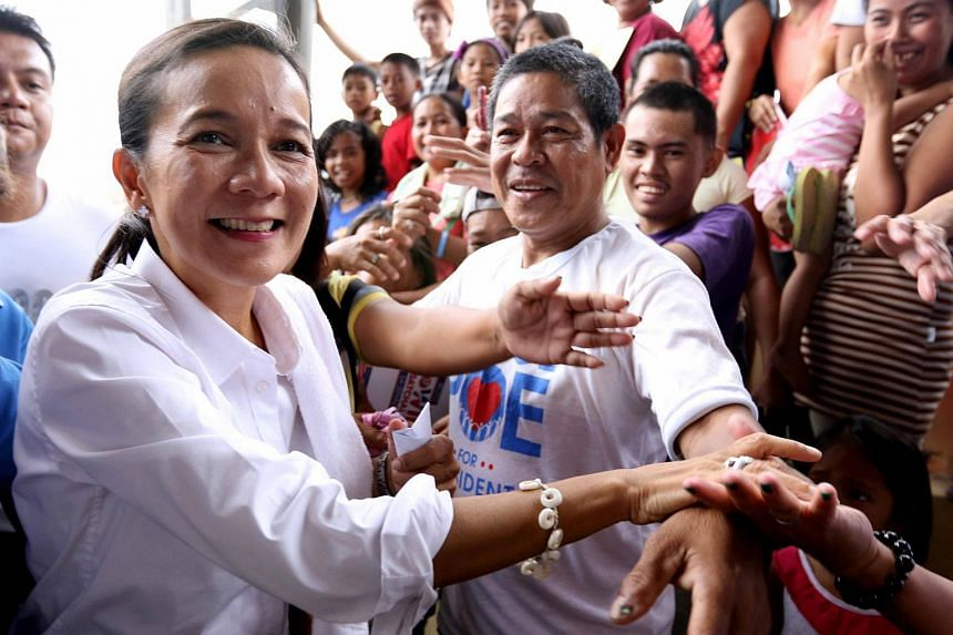 Philippine presidential candidate Grace Poe greeting supporters in Meycauyan, Bulacan province, on May 6.