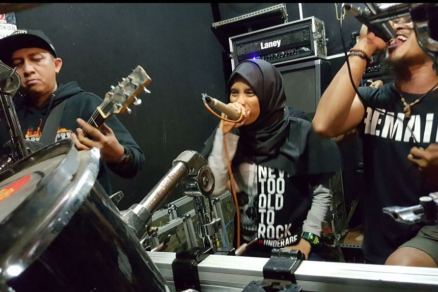 In the day, Ustad Metal is Quran teacher Mr Alfian, while Gugat vocalist Ms Asri (阿伯) teaches pre-schoolers and is a mother of two. The singers are among a growing legion of Indonesians drawn to metal music.