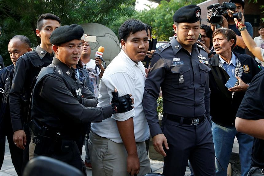 Student activist Sirawith Seritiwat is detained by the police while demonstrating alone against a military-backed draft constitution in Bangkok on May 1.