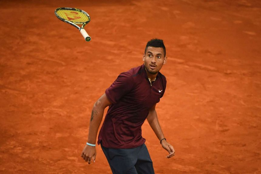 Nick Kyrgios plays against Japan's Kei Nishikori during the Madrid Open tournament at the Caja Magica (Magic Box) sports complex in Madrid on May 6, 2016.