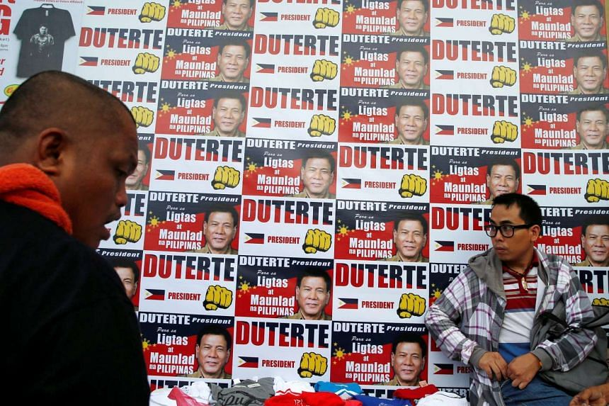 "Posters of presidential candidate Rodrigo ""Digong"" Duterte a day before the election in Davao city on May 8, 2016."