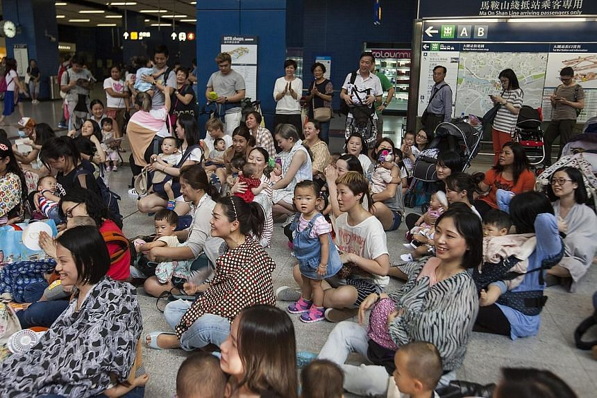 More than 100 nursing mothers took part in a breastfeeding flash mob inside Hong Kong's Tai Wai subway station yesterday. The activists were advocating for more public awareness on breastfeeding rights in the face of discouragement and prejudice agai