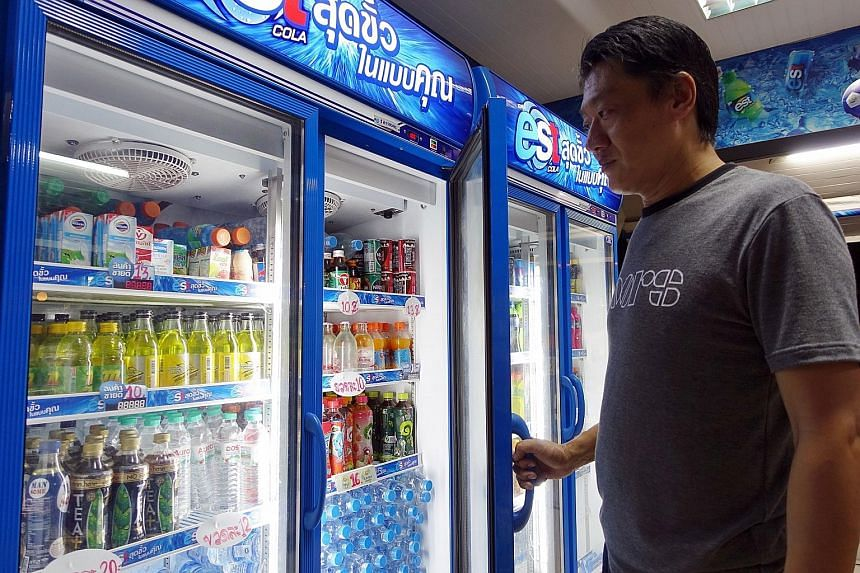 Bangkok shopkeeper Chaiwat Pawanthapong disagrees with the proposal to impose a tax on sugary drinks. He says it would be a burden on people already grappling with gloomy economic conditions.