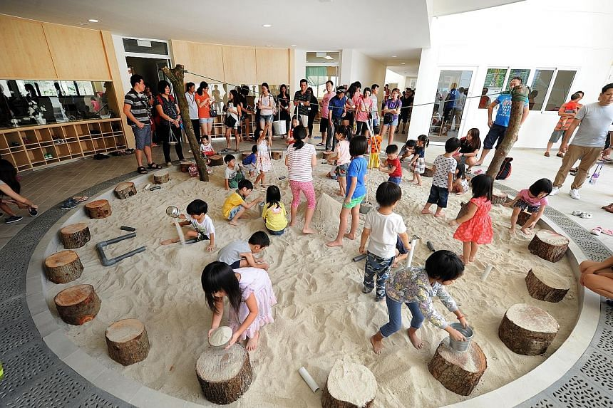 """Children playing in one of the centre's five """"pods"""", featuring a sand pit which represents """"earth"""", during the official opening yesterday."""