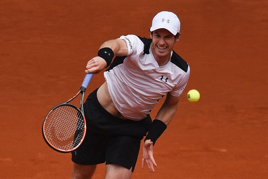 World No. 2 Andy Murray serving to rival Rafael Nadal in their Madrid Open semi-final yesterday. The defending champion recorded eight aces and saved 11 break points to hand Nadal his first loss in 14 matches.