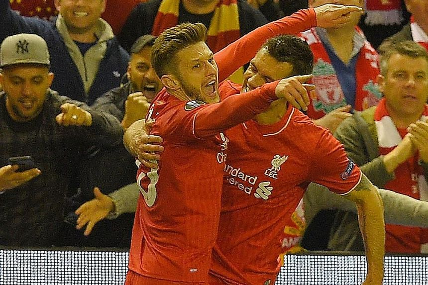 Liverpool midfielder Adam Lallana (left) celebrates with Dejan Lovren after scoring against Villarreal on Thursday. It was his fifth goal in 14 European matches this season. In 22 league games, he has four goals.