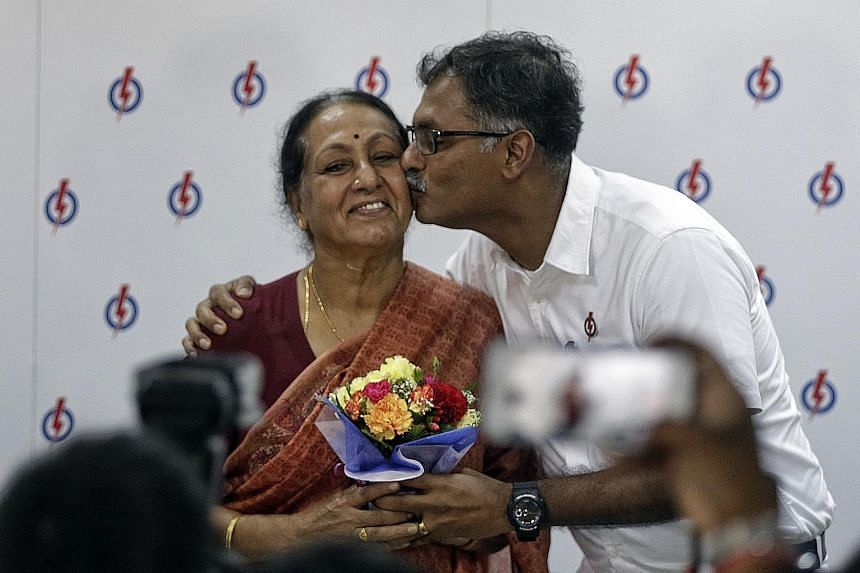 It was a loving kiss for Amma from Ah Mu. After his press conference, Mr Murali presented his mother, Madam Vasanthi Ramadass, 75, with a bouquet of flowers. He also wished all mothers a happy Mother's Day.