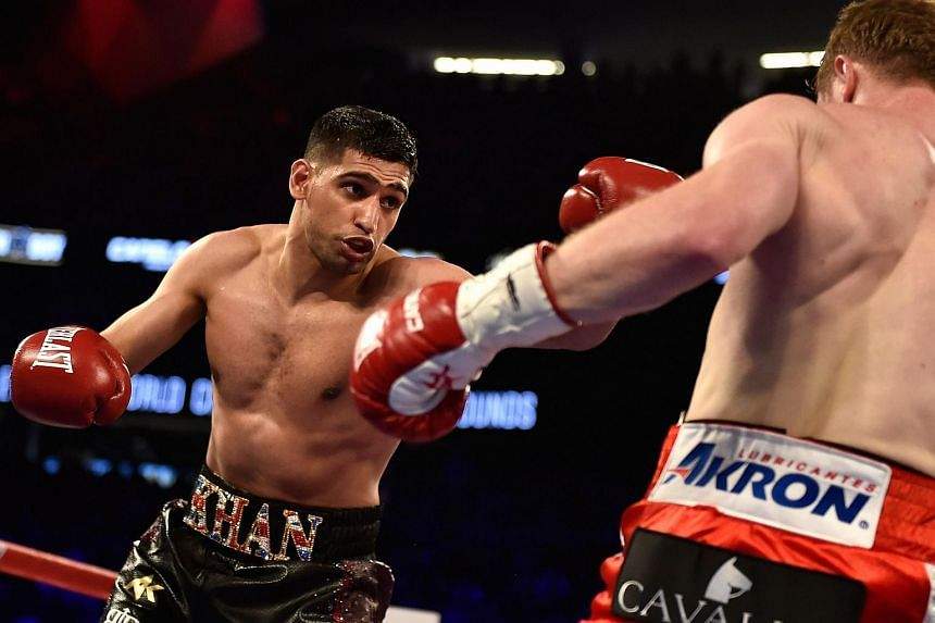 Amir Khan (left) and Canelo Alvarez battle during a WBC middleweight title fight at T-Mobile Arena on May 7, 2016 in Las Vegas, Nevada.