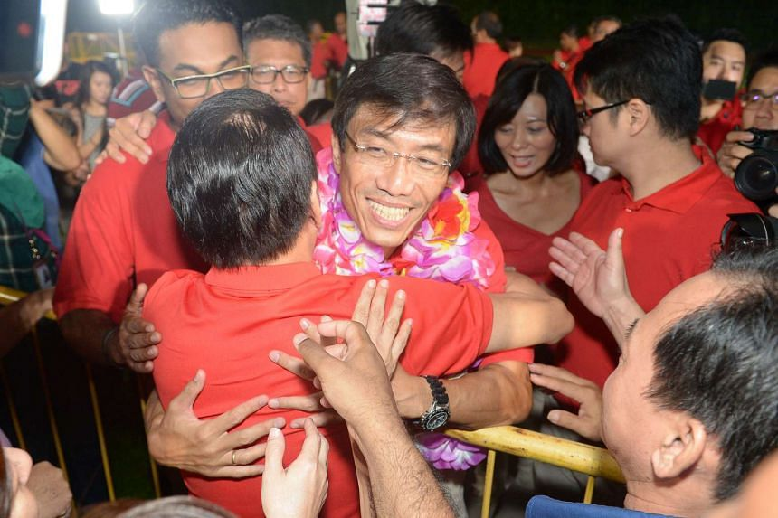 A smiling Dr Chee hugging a supporter despite his loss.