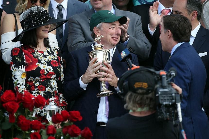 Owner Paul Reddam celebrates in winners circle after Nyquist #13 won the 142nd running of the Kentucky Derby at Churchill Downs in Louisville, Kentucky.