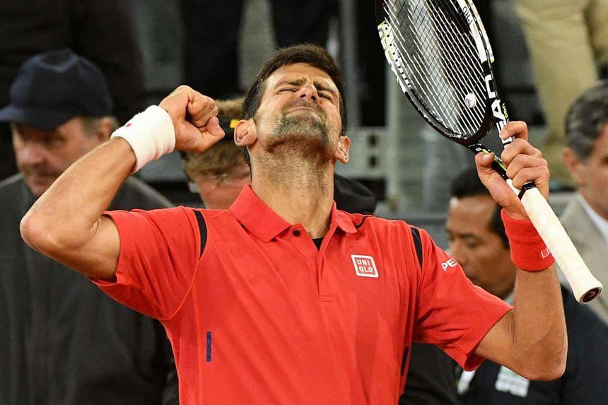 Djokovic celebrates the win that takes him into the Madrid Open final.