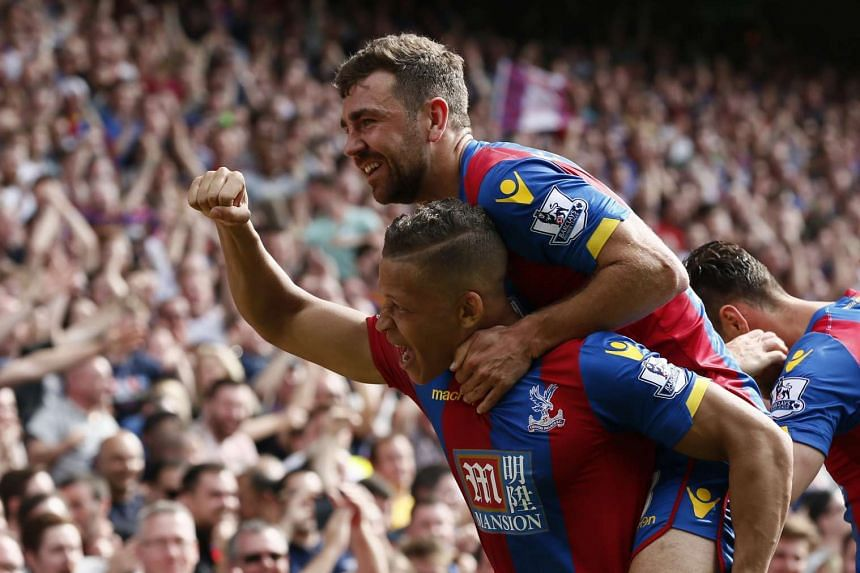 Dwight Gayle celebrates with James McArthur after scoring the second goal for Crystal Palace.