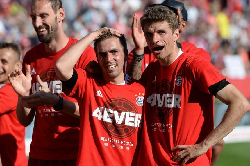 Munich's Philipp Lahm and Thomas Mueller celebrate winning the German Championships.
