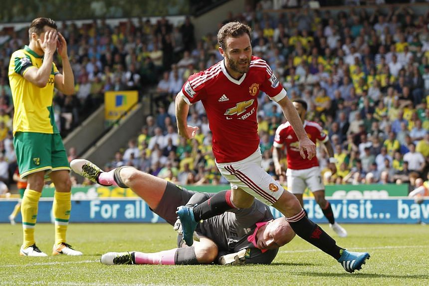 Juan Mata celebrates scoring the first goal for Manchester United against Norwich City.