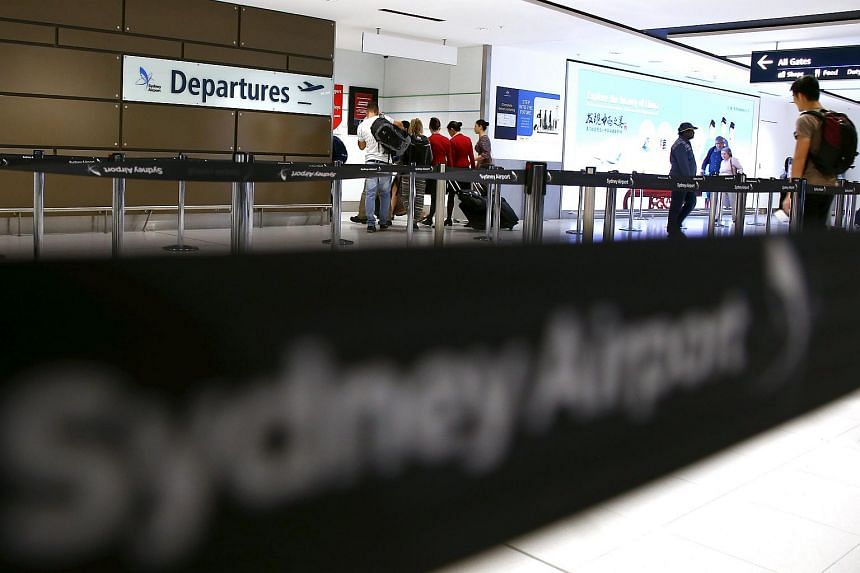 Passengers walk towards the departures area at Sydney International Airport, Australia, on March 23, 2016.