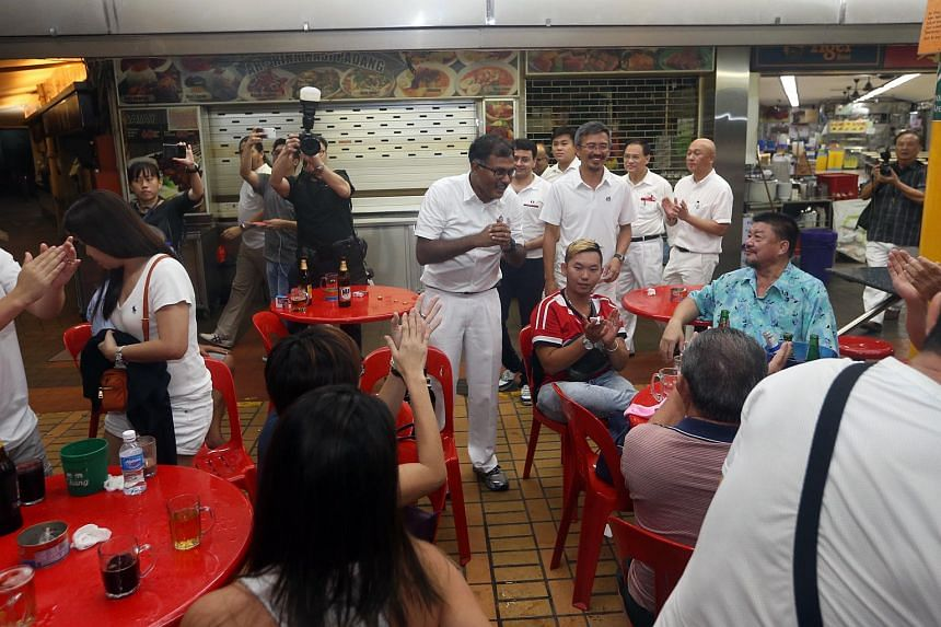 PAP's Murali Pillai thanks residents at a coffee shop after winning the Bukit Batok SMC By-election.
