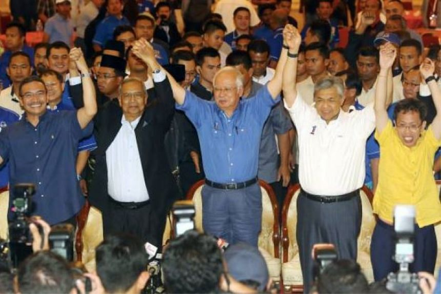 Malaysia Prime Minister Najib Razak (centre) celebrating Barisan's victory with (from left:) Defence minister Hishammuddin Hussein, Sarawak Chief Minister Adenan Satem, Deputy PM Ahmad Zahid Hamidi and Sarawak United Peoples' Party president Sim Kui