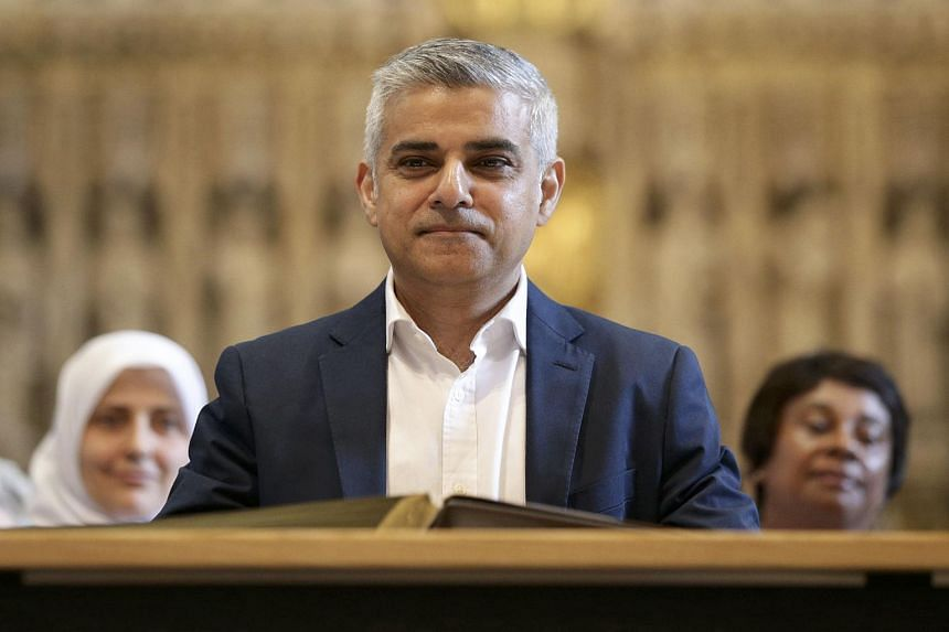 London's new mayor Sadiq Khan attends the signing ceremony in Southwark Cathedral, London, Britain, on May 7, 2016.