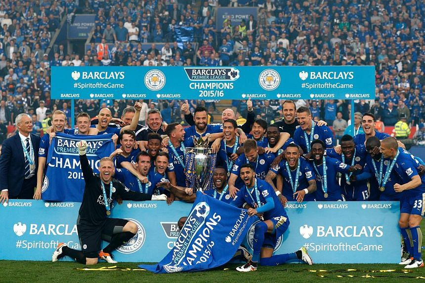 Leicester City players pose with the Premier League trophy after winning the English Premier League football match between Leicester City and Everton at King Power Stadium in Leicester.