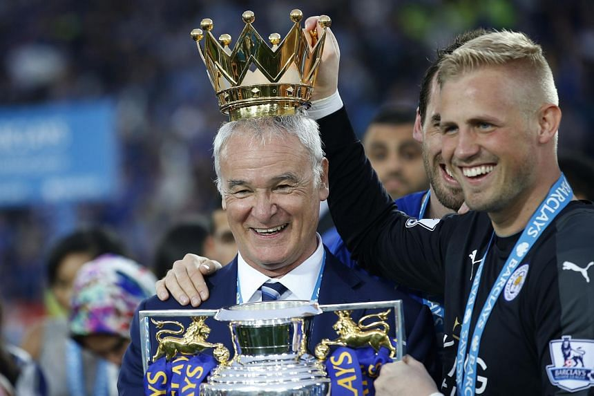 Claudio Ranieri lifts the trophy with Kasper Schmeichel as they celebrate winning the Barclays Premier League.