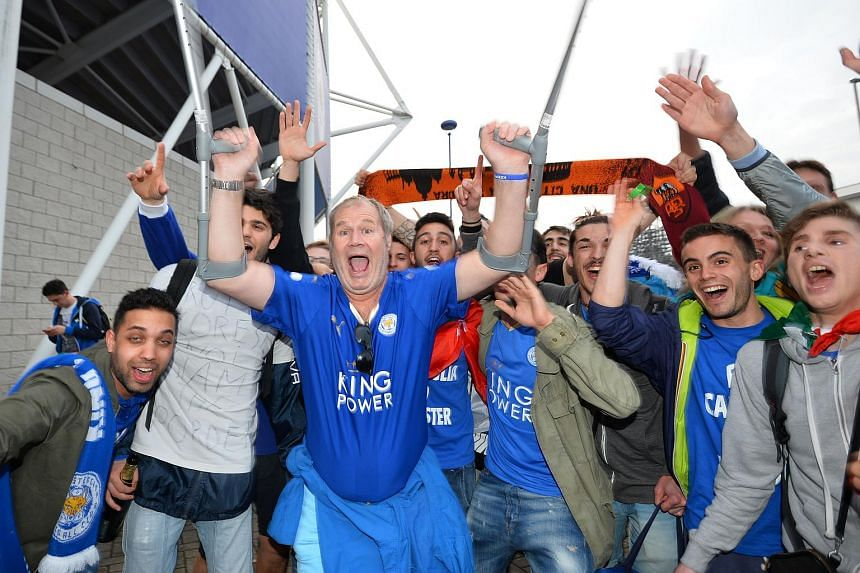 Leicester City supporters celebrate outside the stadium after the English Premier League football match between Leicester City and Everton at King Power Stadium in Leicester.