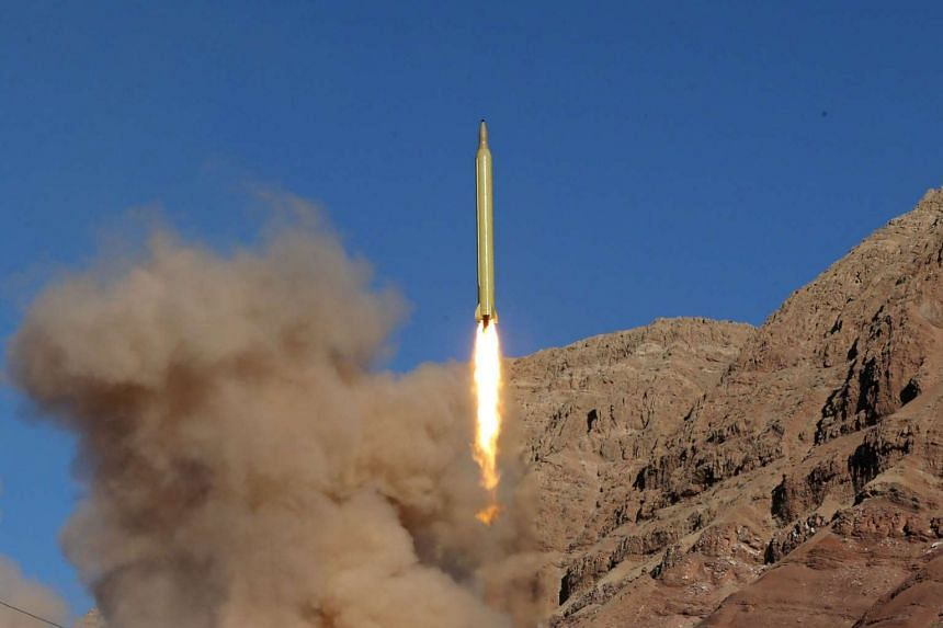 A ballistic missile is launched and tested in an undisclosed location in Iran, on March 9, 2016.