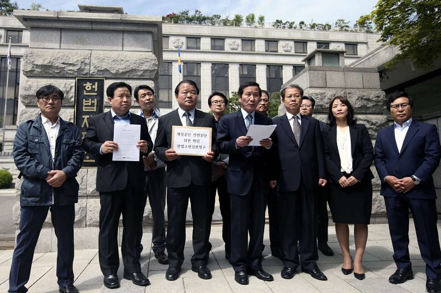 Officials of South Korean firms with plants in Kaesong hold a news conference in front of the Constitutional Court in Seoul, on May 9, 2016.