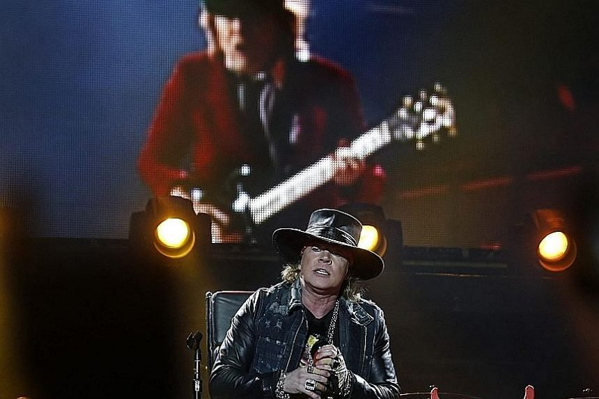 Singer Axl Rose (foreground) performing at the Lisbon gig of Australian rock band AC/DC.