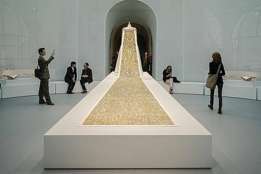 The train on a wedding dress (2014-15, above) by Karl Lagerfeld for Chanel.