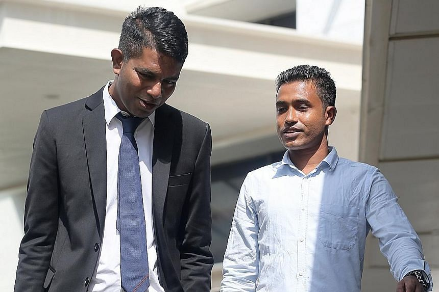 Bangladeshi safety supervisor Shahidulla Md Anser Ali (right) and lawyer Kalidass Murugaiyan, who took on the case pro bono, leaving the court last Friday.