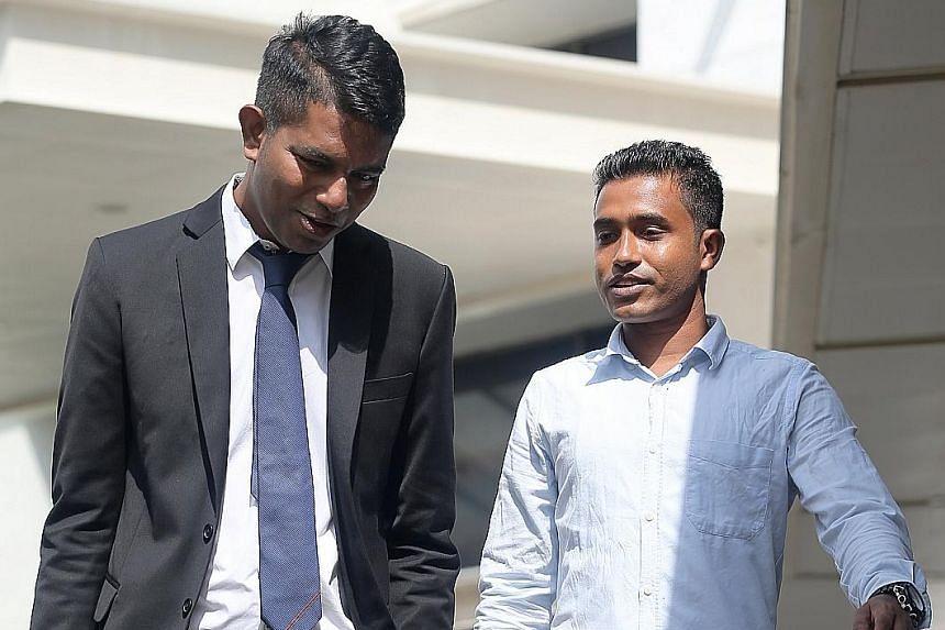 Bangladeshi safety supervisor Shahidulla Md Anser Ali (right) and lawyer Kalidass Murugaiyan, who took on the case pro bono, leaving the court last Friday.