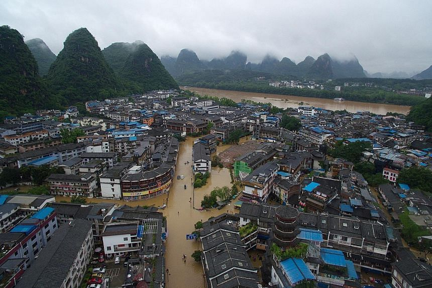 About 250 villagers and tourists are said to be trapped in the flood-hit Yangshuo county in Guangxi region. The area has experienced heavy flooding and massive blackouts after days of torrential rains.