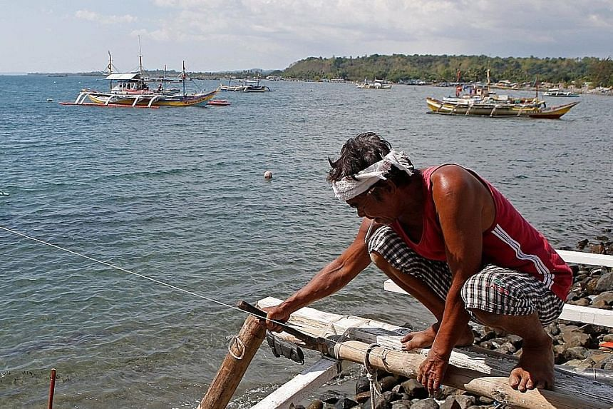 Filipino fishermen from coastal communities around Masinloc in Zambales province rely heavily on the disputed Scarborough Shoal in the South China Sea for their catch and livelihood.