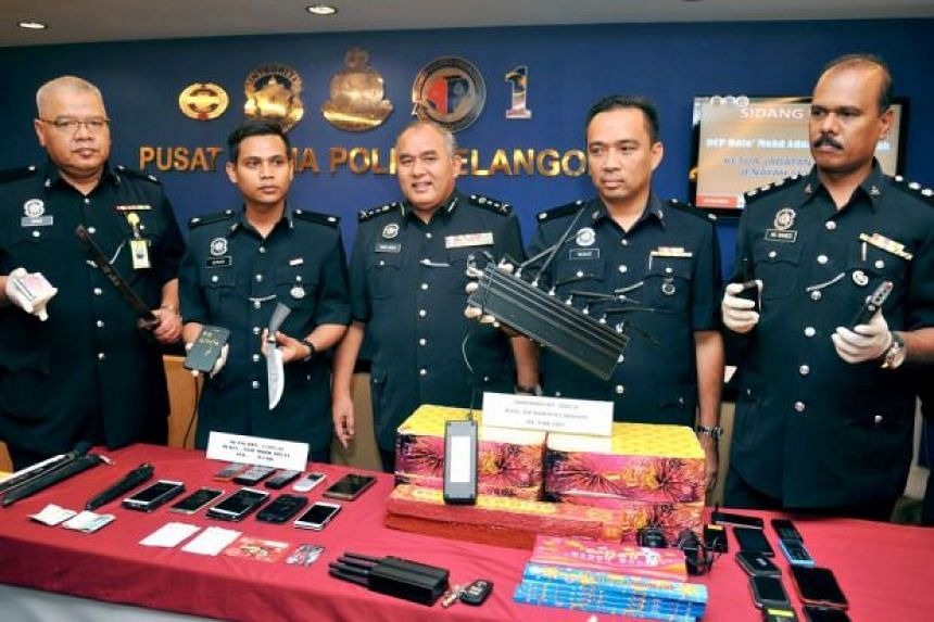Malaysian police displaying some of the items seized in connection with the discovery of homemade bombs in a condominium unit in Kuala Lumpur.