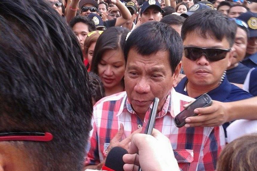 Philippine presidential candidate Rodrigo Duterte casts his vote at a polling station in Davao City, on May 9, 2016.