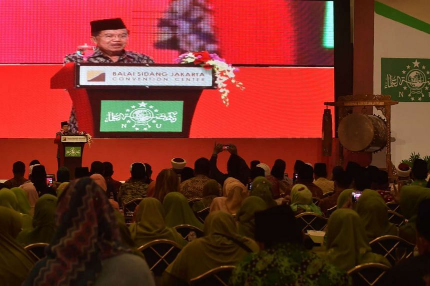 Indonesia's Vice President Jusuf Kalla (on stage) delivers a speech during the opening ceremony of the International Summit of Moderate Islamic Leaders in Jakarta.