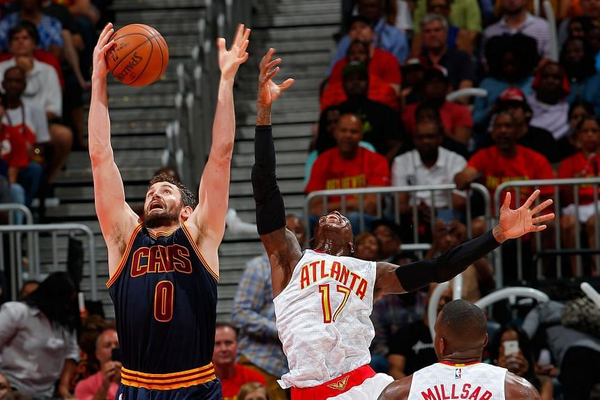 Kevin Love #0 of the Cleveland Cavaliers catches a pass against Dennis Schroder #17 of the Atlanta Hawks in Game Four of the Eastern Conference Semifinals during the 2016 NBA Playoffs.
