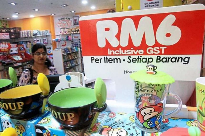 A sign showing the price items which include GST at a supermarket in Malaysia.