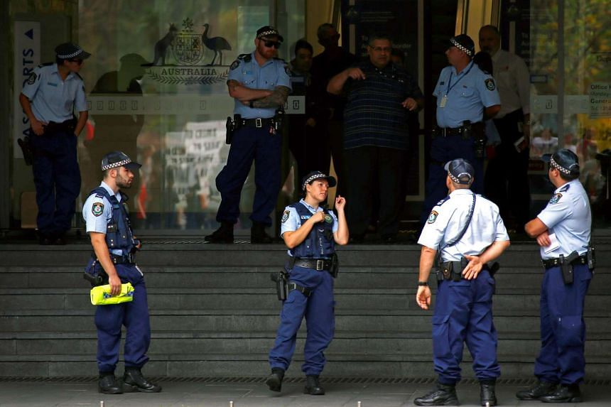 Police standing guard outside the offices of the Australian Government Department of Immigration and Border Protection, on April 29, 2016.