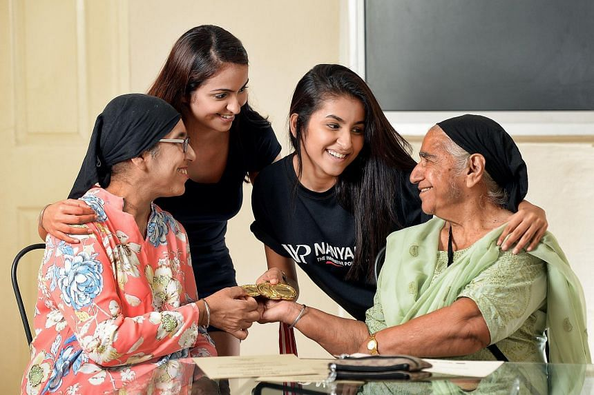 Ms Prabhmeet Kaur (second from right) from Nanyang Polytechnic's School of Business Management with (from left) her mother Sukhwant Kaur, sister Dalvin Kaur and grandmother Surinder Kaur.