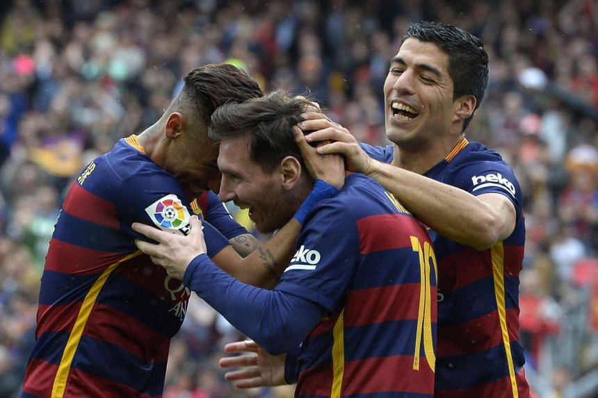Barcelona's Lionel Messi (centre) celebrates with Neymar and Luis Suarez (right) after scoring a goal against RCD Espanyol on Sunday (May 8).