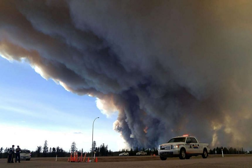 Members of the Royal Canadian Mounted Police monitor the Fort McMurray Wildfire.