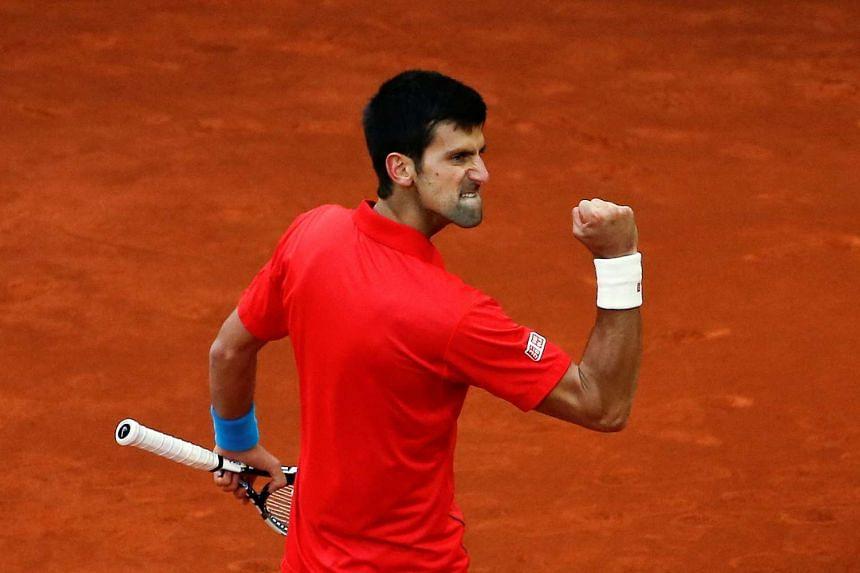 Novak Djokovic celebrates winning a point.