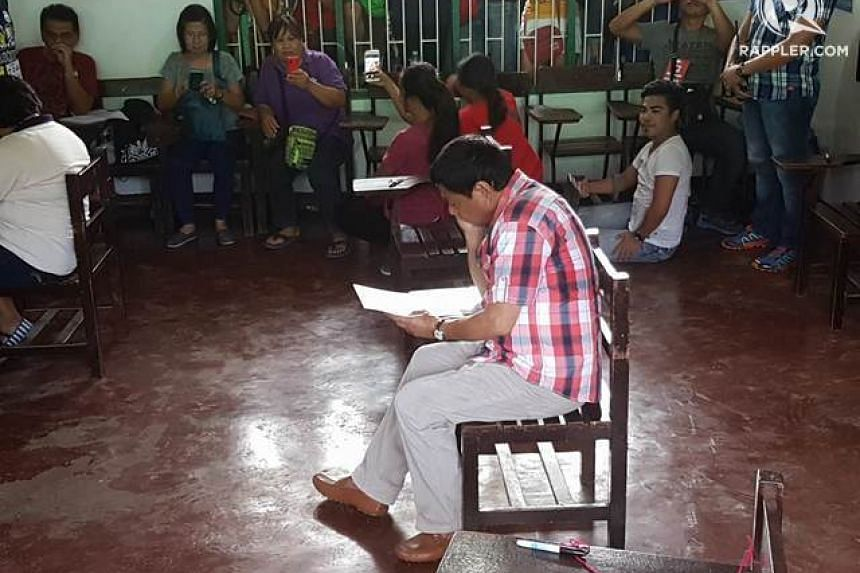 Philippine presidential candidate Rodrigo Duterte casts his vote in Davao City, on May 9, 2016.