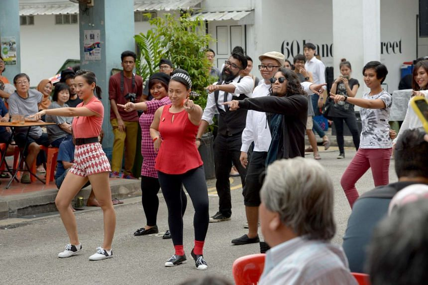 A group of dancers from Soul Shakers Singapura (above) bust out moves to hits from the 1960s on Bussorah Street over the weekend during A-Go-Go Night @ Kampong Gelam.