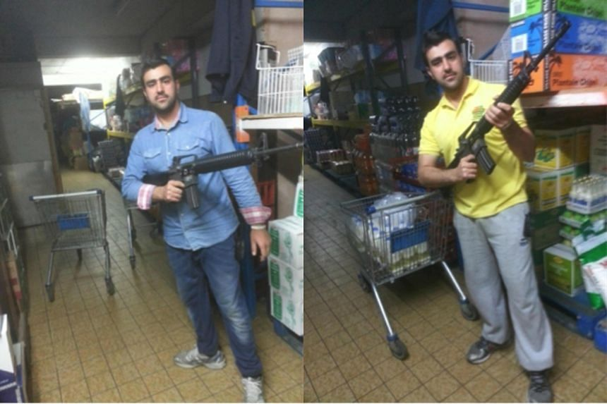 Undated handout photographs released by Italian Police Carabinieri on May 10, 2016, shows alleged Afghan terrorist Hakim Nasiri holding a gun.