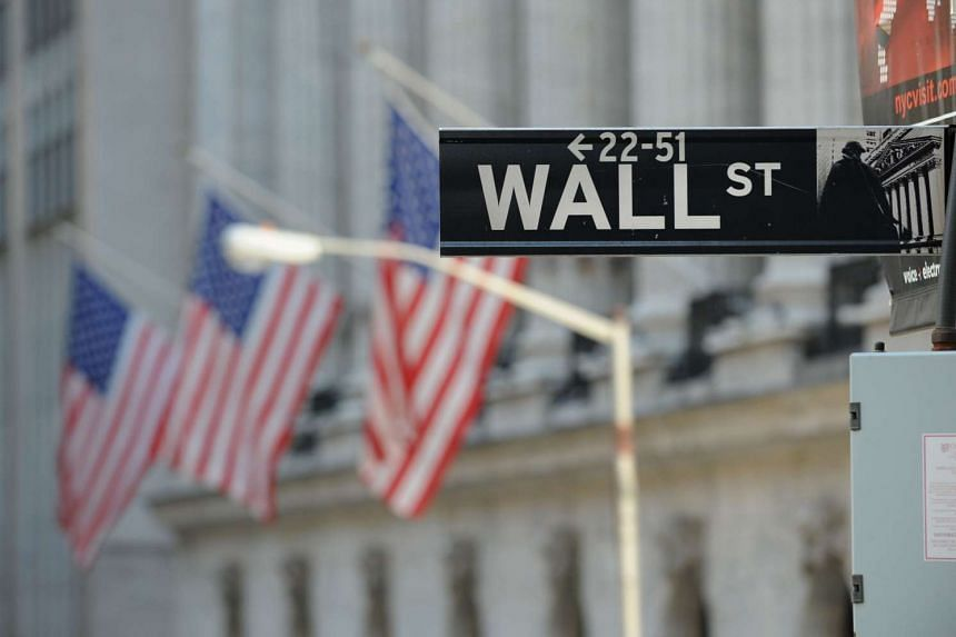 The Wall Street sign outside the New York Stock Exchange in New York, on Feb 28, 2012.