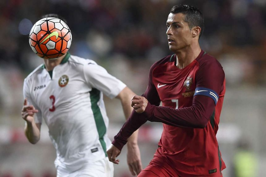 Portugal's forward Cristiano Ronaldo (right) in action during the Euro 2016 friendly football match Portugal vs Bulgaria in Leiria, on March 25, 2016.